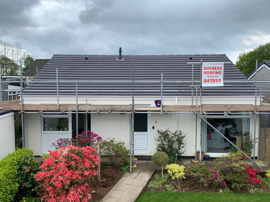 Bungalow with new roof installation and scaffolding